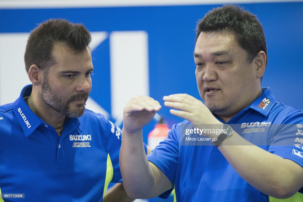 Ken Kawauchi (R) of Japan and Technical Manager of Suzuki MotoGP Projec speaks in box during the MotoGp of Qatar - Qualifying at Losail Circuit on March 25, 2017 in Doha, Qatar.