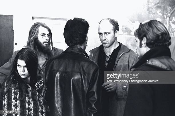 Ken Kesey and a few of his Merry Pranksters have a discussion