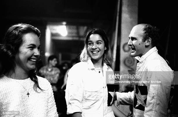 Ken Kesey and his wife Faye talk with his girlfriend Mountain Girl