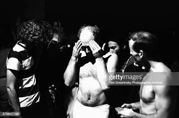 Ken Kesey and Neal Cassady talk to people at the Merry Pranksters' Acid Test Graduation Neither of them are wearing shirts