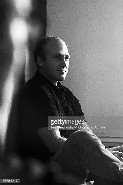 Ken Kesey author of One Flew Over the Cukoo's Nest and leader of the Merry Pranksters sits on a mattress at a friend's apartment in San Francisco