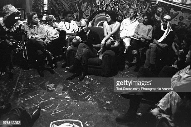 Ken Kesey has called a meeting of the Merry Pranksters leaders to plan for the Acid Test Graduation