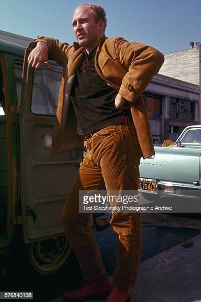 Ken Kesey stands on Harriet Street before the Acid Test Graduation San Francisco California | Location outside the Warehouse Harriet Street South of...