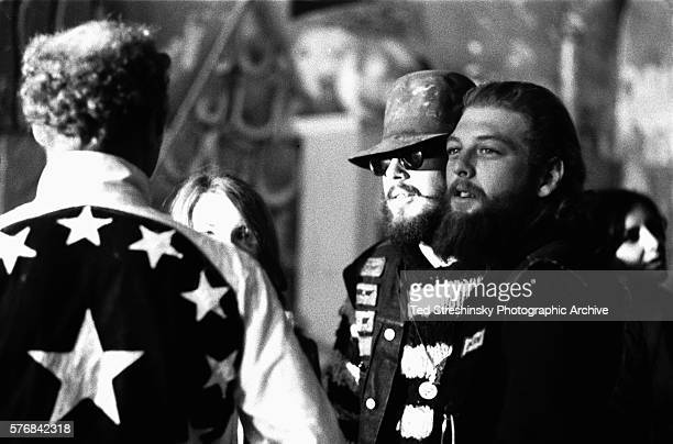 Ken Kesey[l] talks with some Hell's Angels at the Merry Pranksters' Acid Test Graduation