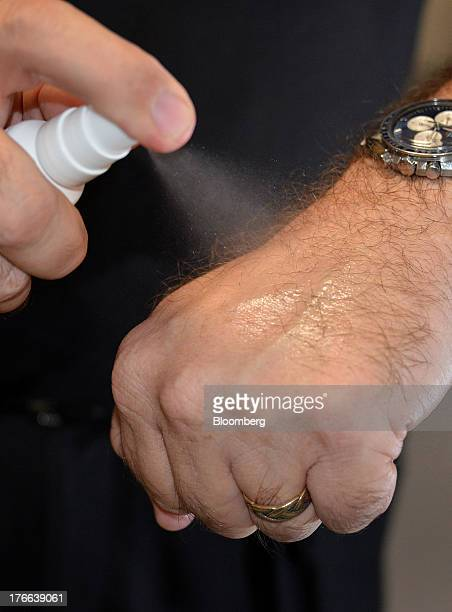 Ken Kirby president of Transdermal Delivery Solutions sprays diclofenac sodium a nonsteroidal antiinflammatory drug on his skin in Palm Beach Gardens...