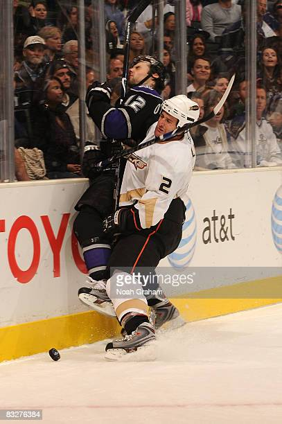 Ken Klee of the Anaheim Ducks checks Patrick O'Sullivan of the Los Angeles Kings into the boards during the game on October 14 2008 at Staples Center...