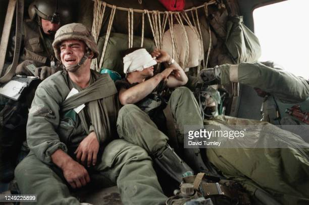 Ken Kozakiewicz and Michael Tsantarakis are air lifted to safety in a Helicopter after being injured in the Gulf War.   Location: Near Border of...
