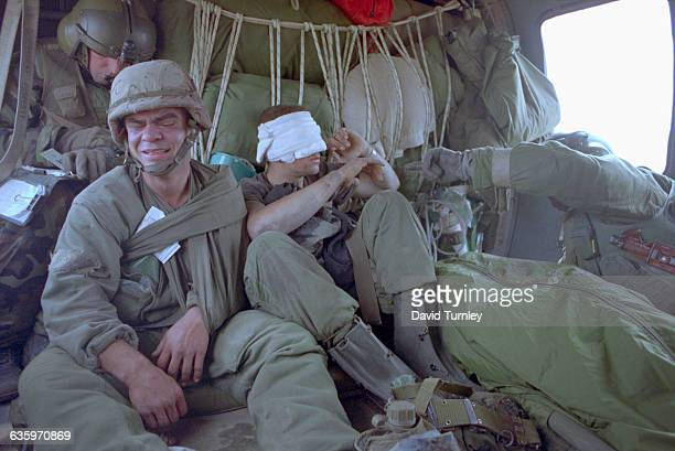 Ken Kozakiewicz and Michael Tsantarakis are air lifted to safety in a Helicopter after being injured in the Gulf War | Location Near Border of Saudi...