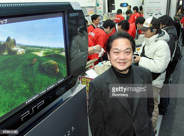Ken Kutaragi President CEO of Sony Computer Entertainment stands at an electronics shop as customers buy Sony's new PlayStation Portable video game...