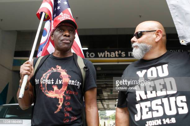 Ken Lane a supporter of President Donald Trump and QAnon and Ruben Israel of Bible Believers talk about their political beliefs near the Republican...