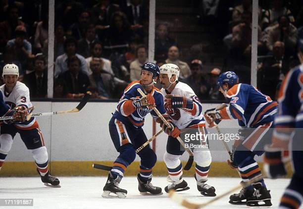 Ken Linesman of the Edmonton Oilers defends against Bryan Trottier of the New York Islanders during the 1984 Stanley Cup Finals in May 1984 at the...