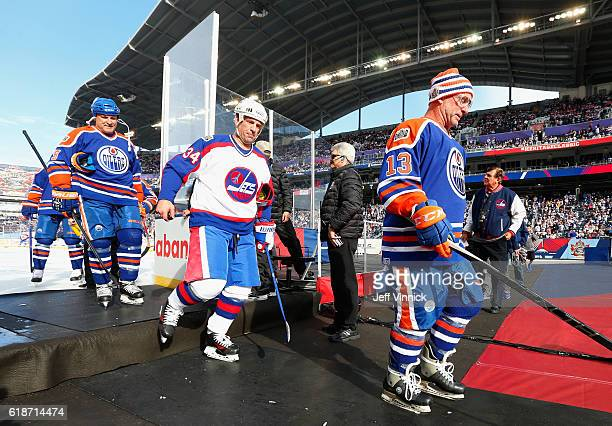 Ken Linseman of the Edmonton Oilers alumni and Darrin Shannon of the Winnipeg Jets alumni leaves the ice after warming up before the 2016 Tim Hortons...
