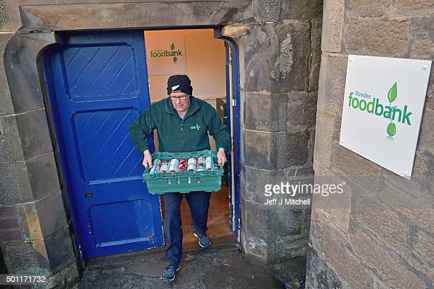 Ken Linton a manager at the Trussell Trust Constitution Street food bank carries a tray of cans of food from the Trussell Trust Constitution Street...