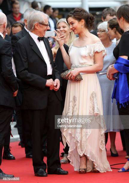 Ken Loach and Aisling Franciosi joke before the Jimmy's Hall Premiere at the 67th Annual Cannes Film Festival on May 22 2014 in Cannes France