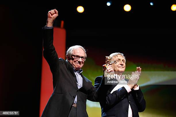 Ken Loach receives his Honoray Golden Bear next director Jiri Menzel during the 64th Berlinale International Film Festival at Berlinale Palast on...