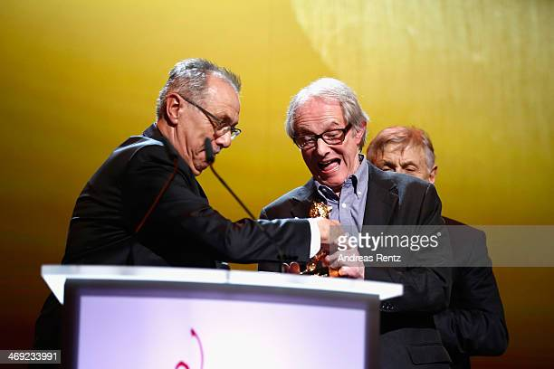 Ken Loach receives his Honoray Golden Bear next to festival director Dieter Kosslick during the 64th Berlinale International Film Festival at...