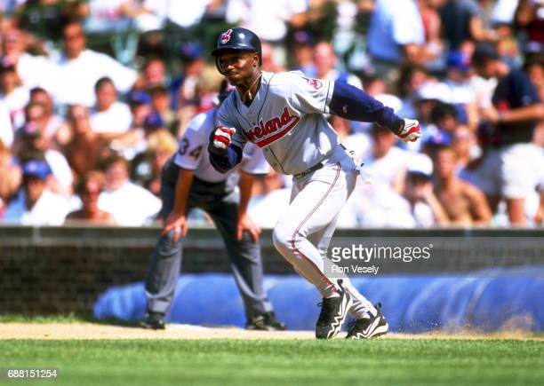Ken Lofton of the Cleveland Indians attempts to steal second base during an MLB game versus the Chicago Cubs at Wrigley Field in Chicago Illinois...