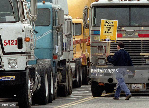 """Ken Lubas –– Teamsters are trying to organize independent truckerss in the county ports. Trucker heads to his rig for """"giant"""" truck convoy from the..."""