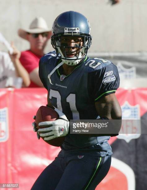 Ken Lucas of the Seattle Seahawks returns an interception for a touchdown and a 17-16 lead against the Arizona Cardinals in the fourth quarter at Sun...