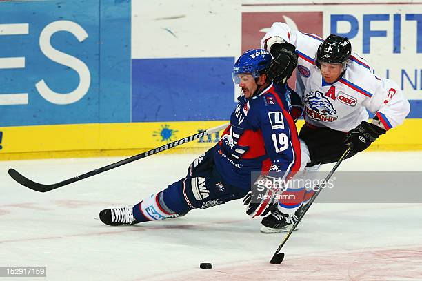 Ken Magowan of Mannheim is challenged by Casey Borer of Ice Tigers during the DEL match between Adler Mannheim and Thomas Sabo Ice Tigers at SAP...