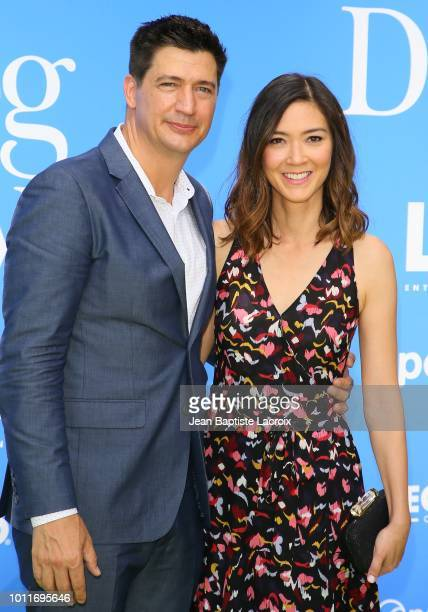 Ken Marino and Erica Oyama attend the premiere of LD Entertainment's 'Dog Days' at Westfield Century City on August 5 2018 in Century City California