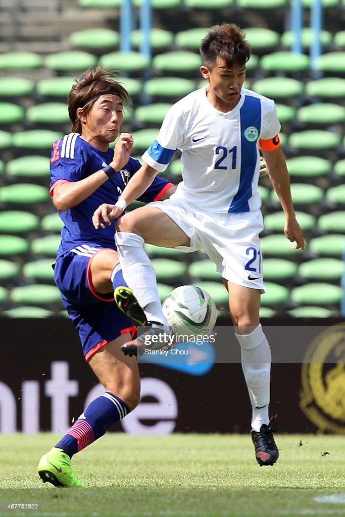 Ken Matsubara of Japan challenges Pang Chi Hang of Macau during the AFC U23 Championship Qualifier Group I match between Japan and Macau at Shah Alam Stadium on March 27, 2015 in Shah Alam, Malaysia.