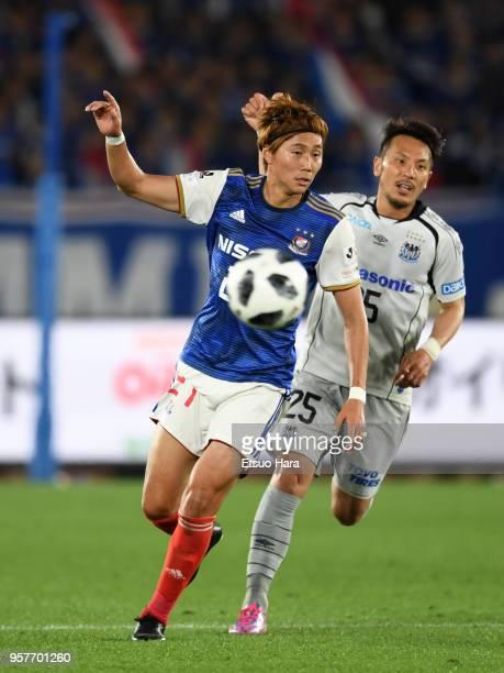 Ken Matsubara of Yokohama FMarinos and Jungo Fujimoto of Gamba Osaka compete for the ball during the JLeague J1 match between Yokohama FMarinos and...
