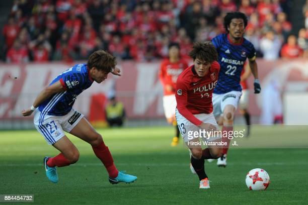 Ken Matsubara of Yokohama FMarinos and Toshiyuki Takagi of Urawa Red Diamonds compete for the ball during the JLeague J1 match between Urawa Red...