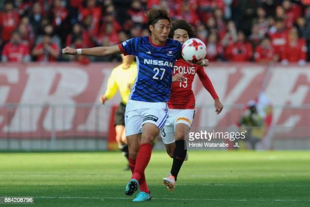 Ken Matsubara of Yokohama FMarinos controls the ball under pressure of Toshiyuki Takagi of Urawa Red Diamonds during the JLeague J1 match between...