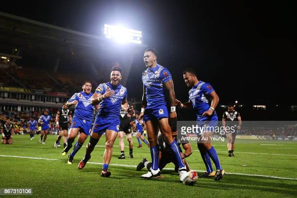 Ken Maumalo of Samoa celebrates after scoring a try during the 2017 Rugby League World Cup match between the New Zealand Kiwis and Samoa at Mt Smart...