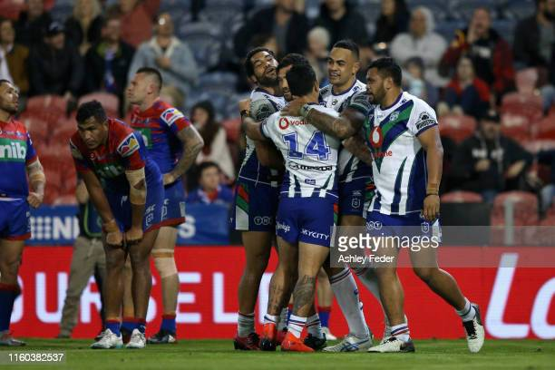 Ken Maumalo of the New Zealand Warriors celebrates his try with team mates during the round 16 NRL match between the Newcastle Knights and the New...