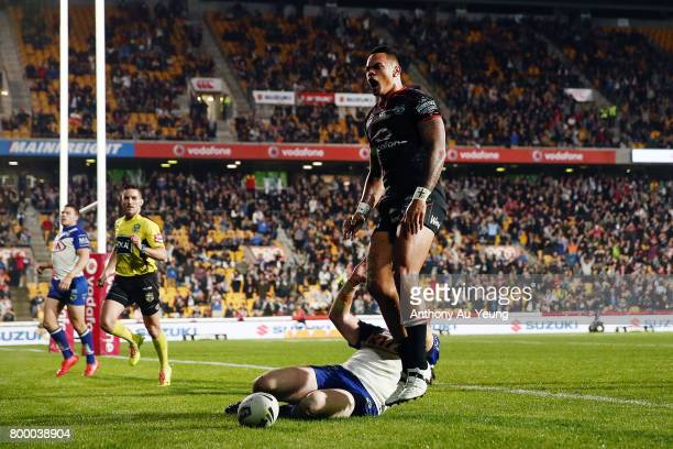 Ken Maumalo of the Warriors celebrates after scoring a try against James Graham of the Bulldogs during the round 16 NRL match between the New Zealand...