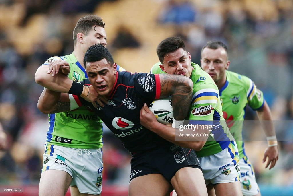 Ken Maumalo of the Warriors is tackled by Aidan Sezer and Joseph Tapine of the Raiders during the round 23 NRL match between the New Zealand Warriors and the Canberra Raiders at Mt Smart Stadium on August 13, 2017 in Auckland, New Zealand.