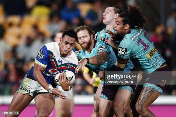 Ken Maumalo of the Warriors makes a run against Korbin Sims and Adam Blair of the Broncos during the round 12 NRL match between the New Zealand...