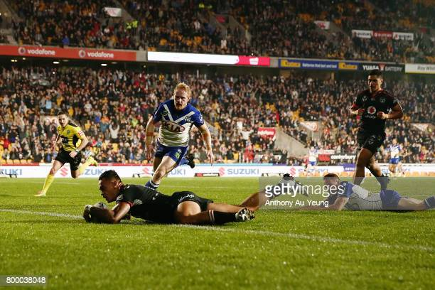 Ken Maumalo of the Warriors scores a try during the round 16 NRL match between the New Zealand Warriors and the Canterbury Bulldogs at Mt Smart...