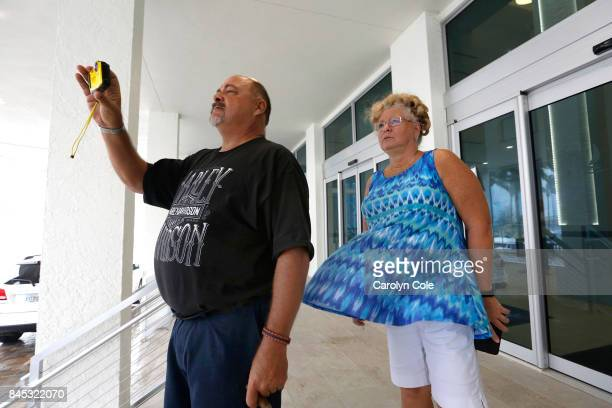 Ken McNeal and Diana Frana, of Ft. Myers watch the hurricane winds at Campo Felice. In Ft. Myers, Florida, hurricane winds are building as the...