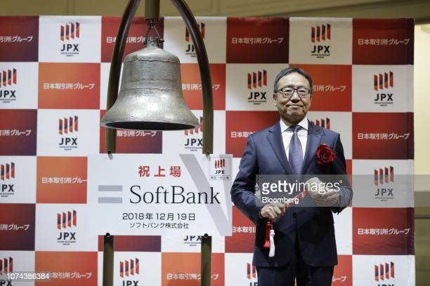 Ken Miyauchi, president and chief executive officer of SoftBank Corp., poses for a photograph before striking the trading bell during the company's...