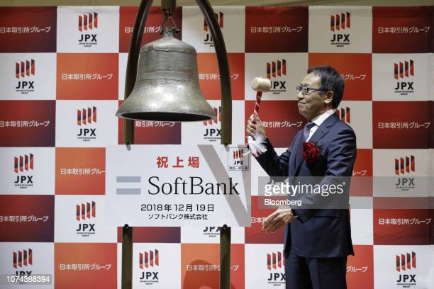 Ken Miyauchi president and chief executive officer of SoftBank Corp strikes the trading bell during the company's listing ceremony at the Tokyo Stock...