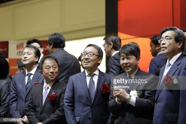 Ken Miyauchi, president and chief executive officer of SoftBank Corp., center, attends the company's listing ceremony at the Tokyo Stock Exchange in...