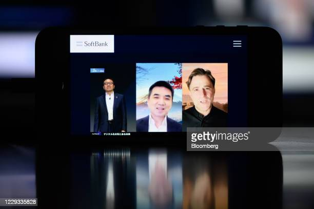 Ken Miyauchi, president and chief executive officer of SoftBank Corp., left, Eric S. Yuan, chairman and chief executive officer of Zoom Video...