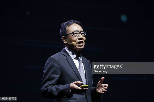 Ken Miyauchi, president and chief executive officer of SoftBank Mobile Corp., speaks during the annual Huawei Global Mobile Broadband Forum in Chiba,...
