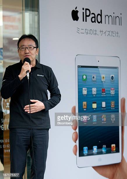 Ken Miyauchi, vice president and chief operating officer of Softbank Corp., speaks during a ceremony as the Apple Inc. IPad Mini goes on sale at the...
