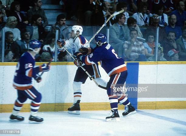 Ken Morrow of the New York Islanders checks Mark Messier of the Edmonton Oilers during the 1984 Stanley Cup Finals in May 1984 at the Northlands...