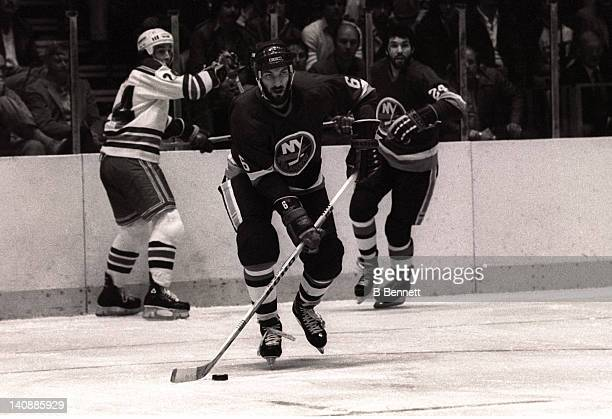 Ken Morrow of the New York Islanders skates with the puck during Game 3 of the 1982 Division Finals against the New York Rangers on April 18 1982 at...