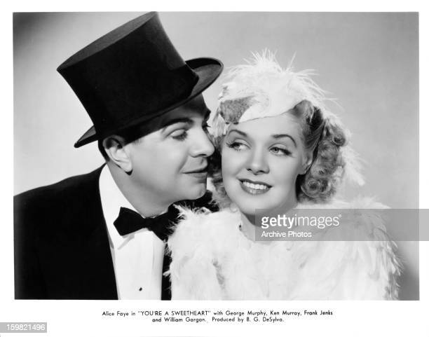 Ken Murray cozying up to Alice Faye in publicity portrait for the film 'You're A Sweetheart' 1937