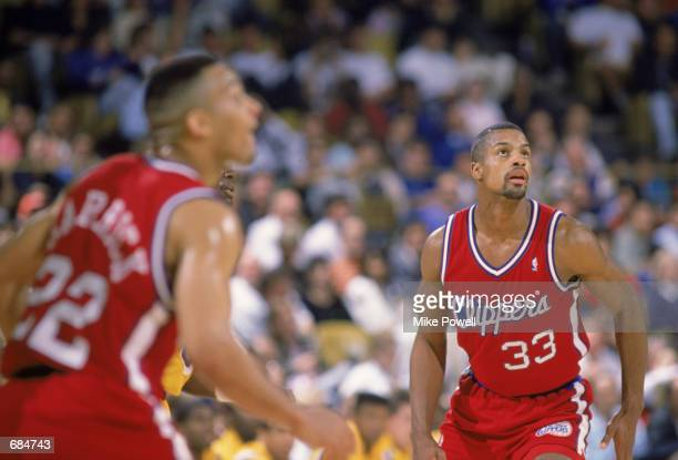 Ken Norman of the Los Angeles Clippers attempts to rebound the ball during the NBA game against the Los Angeles Lakers at the Great Western Forum in...