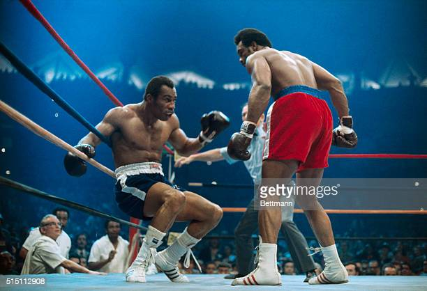 Ken Norton is groggy on the ropes after receiving a blow from heavyweight George Foreman.