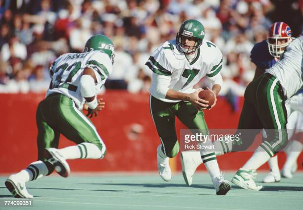 Ken O'Brien Quarterback for the New York Jets carries the ball out to his Running Back Blair Thomas during their American Football Conference East...