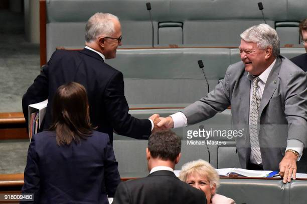 Ken O'Dowd from The Nationals shakes the hand of Malcolm Turnbull the Prime Minister afer responding to a question from the opposition during...