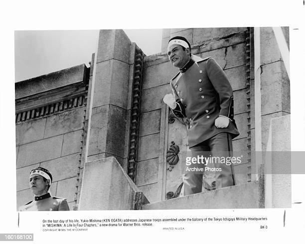 Ken Ogata is assembled on the balcony on the last day of his life in a scene from the film 'Mishima A Life In Four Chapters' 1985